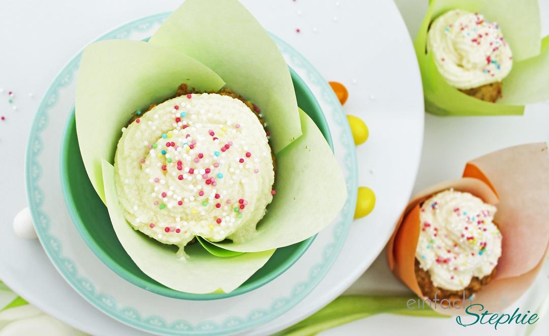 Rübli Muffins in Tulpenfömchen gebacken mit Orangenfrosting